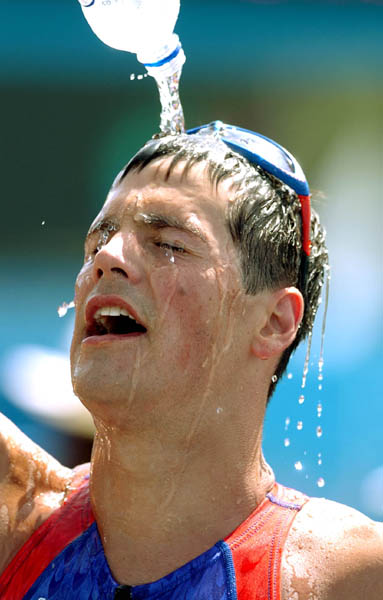 Andy Potts of the U.S. pours water over his face after running in the Triathlon event at  the Athens 2004 Summer Olympic Games Thursday August 26, 2004. Potts came in 22nd. (CP PHOTO/COC-Andre Forget)