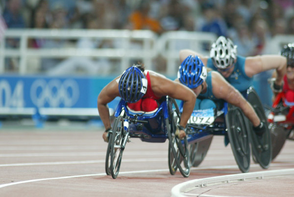 Canada's Chantal Petitclerc of Montreal on her way to the gold medal in women's wheelchair 800 metres in track and field action at the Athens Olympics, Sunday, August 22, 2004.(CP PHOTO/COC-Mike Ridewood)
