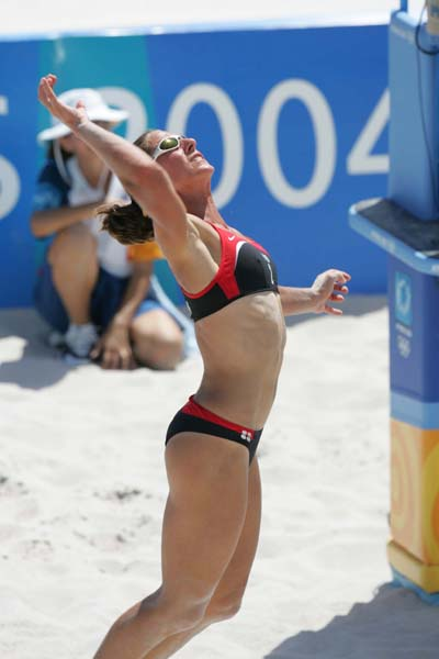 Canada's Annie Martin keeps her eyes on the ball after her hit at the Olympic Games in Athens, on August 14, 2004. (CP PHOTO)2004(COC-Mike Ridewood)