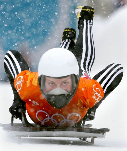 Canadian women's skeleton rider Michelle Kelly jumps onto her sled as she slides down the track during competition Wednesday Feb. 20, at the 2002 Olympic Winter Games in Salt Lake City. (CP Photo/COA/Andre Forget).
