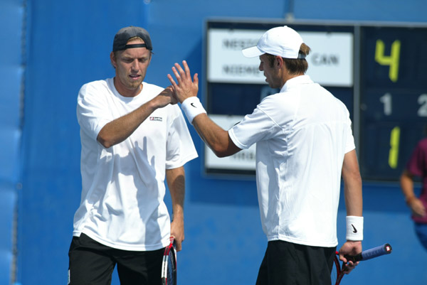 Frederic Niemeyer (left) of Campbellton, N.B. and Daniel Nestor of Willowdale, Ont. won the first round of doubles tennis against Slovakia at the Olympic Games in Athens, Sunday, August 15, 2004. (CP PHOTO/COC-Mike Ridewood)