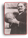 Photograph of James Naismith holding a basketball