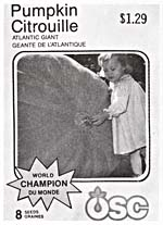 Photograph of a packet of OSC ATLANTIC GIANT pumpkin seeds featuring a photograph of a little girl trying to put her arms around a giant pumpkin