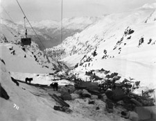 Photograph of a camp at the summit of Chilkoot Pass, April 1898