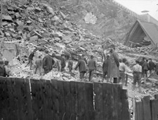 Photograph of men searching through a huge pile of rubble on Champlain Street, Québec, 1889