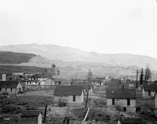 Photograph showing part of the town of Frank, Alberta, and the east end of the slide, 1911