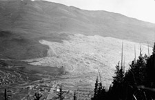 Photograph showing the effects of the rockslide on the town of Frank, 1911