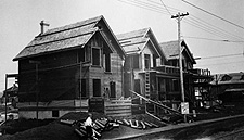Photograph, taken around 1913, of three houses being rebuilt after the 1912 Regina tornado