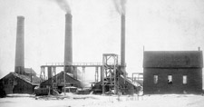 Photograph of a row of three buildings equipped with large smokestacks, number 1 slope, Springhill mine, Nova Scotia, 1897