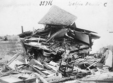 Photograph of debris from the explosion, including parts of houses and furniture, Halifax, 1917