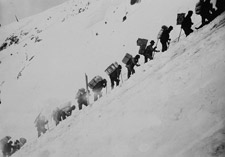 Photograph of prospectors with packs on their backs, ascending the Chilkoot Pass, circa 1898 or 1899