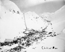 Photograph of a crowd of prospectors arriving at a camp via the Chilkoot Pass