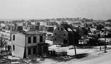 Photograph of a section of Halifax, showing damaged homes, 1917