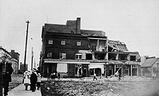 Photograph of a brick building partially torn apart by the tornado, Regina, 1912