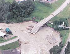 Photograph of a bridge washed out by the flooding, La Baie, Quebec, 1996
