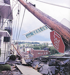 Photograph showing a debris-filled city street damaged by the Saguenay flood, July 1996