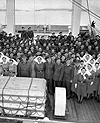 Photograph of nurses and officers on board the re-christened HMCS LETITIA, April 1945