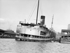 Photograph of the ruins of the S.S. NORONIC after the fire, September 19, 1949