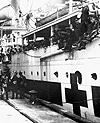 Photograph of a hospital ship being welcomed in Halifax as veterans unload, circa 1918-1925