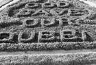 Photograph of flower-bed design displaying the words GOD SAVE OUR QUEEN, Parliament Hill, before 1882