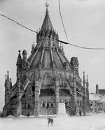 Photograph of Library of Parliament and smoldering Centre Block, February 4, 1916