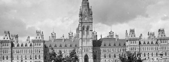 Photograph of Centre Block, showing grounds along Wellington Street, ca. 1910