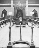 Photograph of the Senate Chamber with view toward the Throne, showing members' seats and visitors' galleries, ca. 1900-1916