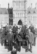Photograph of delegates to the Six Nations Conference standing on the Centre Block steps, March 31, 1910