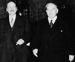 Photograph of Rt. Hon. Clement Attlee of Great Britain walking with Prime Minister Mackenzie King through a corridor of the Centre Block, November 19, 1945