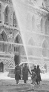 Photograph of firefighters working on east wing of Centre Block, February 4, 1916