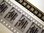 An original 16mm film strip (top) and a negative preservation copy on 35mm film