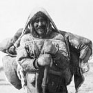 Photograph of an Inuit family travelling overland during summertime at Hudson Bay, Chesterfield Inlet (Igluligaarjuk), Nunavut, 1912 or 1916