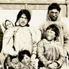 Photograph of a group of Inuit men, women and children from different family groups, Chesterfield Inlet (Igluligaarjuk), Nunavut, summer 1952