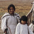 Photograph of three Inuit girls in front of a tent, vicinity of Clyde River (Kangiqtugaapik), Nunavut, no date