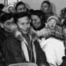 Photograph of a group of people meeting in a community centre, Pangnirtung (Pangnirtuuq), Nunavut, 1965