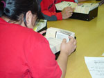 Photograph of Cathy Anablak of Cambridge Bay (Iqaluktuuttiaq) and classmate from Nunavut Sivuniksavut Training Program, searching the card catalogues at Library and Archives Canada, Ottawa, October 2005