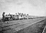 Photo of a trainload of settlers and their effects arriving at Winnipeg from South Dakota, 1891