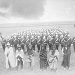Photograph of Lieutenant-Governor Edgar Dewdney, Chief Piapot and his warriors, and the Montreal Garrison Artillery, in Regina, Saskatchewan, 1885