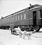 Photograph of a child arriving at the school train by dogsled in Chapleau, Ontario