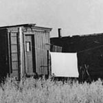 Photograph of old railway cars that were converted into houses for immigrants
