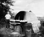 Photograph of an outdoor baking oven, Siftan District, Saskatchewan, 1910