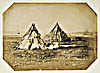 Photograph of four Mik'maq women seated in front of their wigwams, Sydney, Cape-Breton Island , N.S., 1857