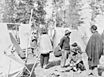 Photograph of Chinese men putting up tents and preparing a camp on the Canadian Pacific Railway, Kamloops, British Columbia, circa 1885