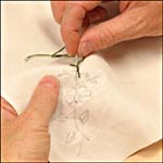 Photograph showing step 4 of how to make an embroidered handkerchief