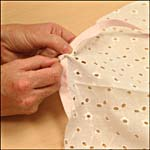 Photograph showing step 2 of how to make a single-ruffle cap