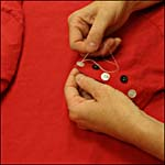 Photograph showing step 2 of how to make a button-decorated T-shirt