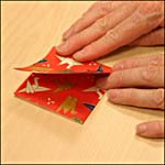 Photograph showing step 5 of how to make an origami box