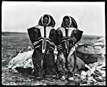 Photograph of Copper Inuit women wearing caribou-skin clothing, Coronation Gulf, Northwest Territories, 1916