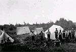 Photograph of men in a camp posing for a photograph, Val-d'Or, Quebec, 1934