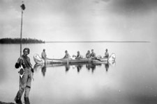 Photograph of surveyors using a disk pole and other equipment to conduct a topographic survey, Lake Mistassini, Quebec, 1884